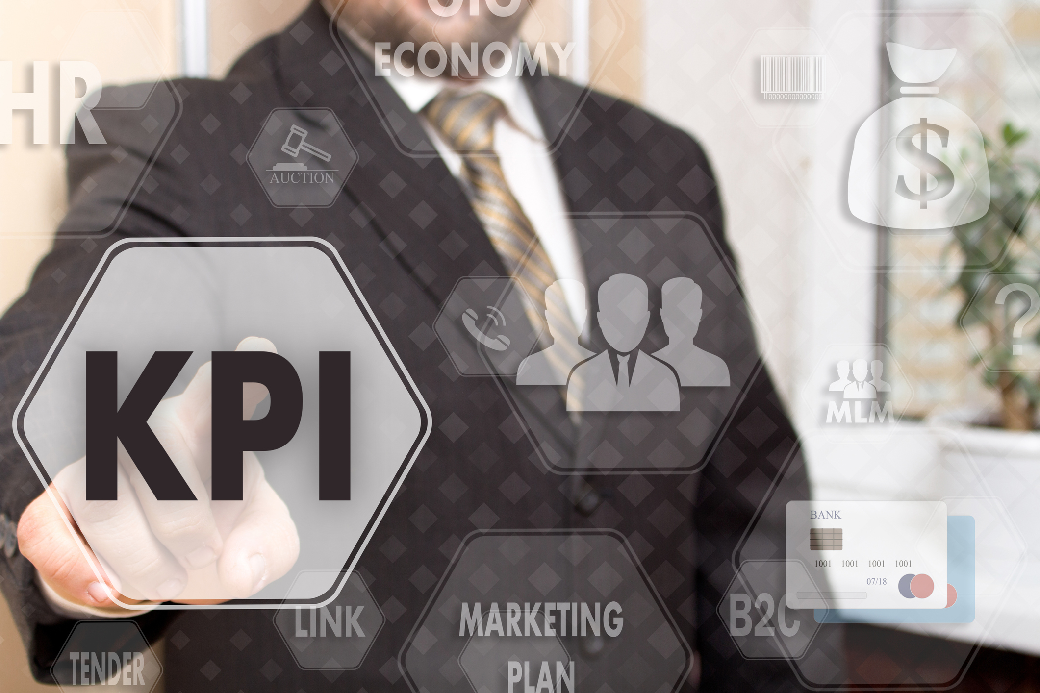 The businessman chooses the KPI, Key Performance Indicator on a touch screen. Concept KPI